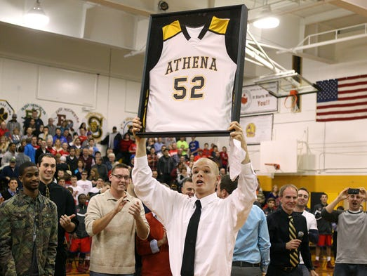 Greece Athena retires J-Mac's number
