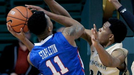 Louisiana Tech's Xavian Stapleton shoots against the pressure of UAB's William Lee during the first half of an NCAA college basketball game at Bartow Arena in Birmingham, Ala., Thursday, Feb. 5, 2015.  (AP Photo/ AL.com, Mark Almond) MAGS OUT