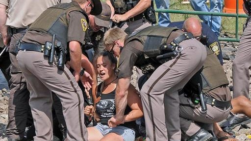 Law enforcement arrest several people protesting the Dakota Access Pipeline on Thursday in Morton County, N.D.