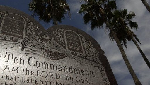 A monument with the Ten Commandments listed sits on the Nueces County Courthouse property.