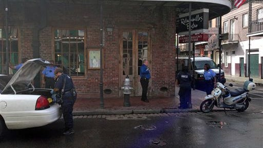 Authorities continue working the scene along Bourbon Street after a shooting, early Sunday in New Orleans. Nine people were shot on Bourbon Street in New Orleans' celebrated French Quarter, leaving at least one person in critical condition.