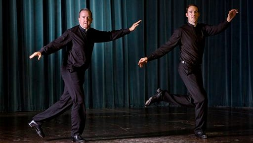 Father David Rider, left, and father John Gibson dance before an interview with the Associated press at the Pontifical North American College in Rome on Oct. 13. A video of a pair of dueling, dancing American priests studying in Rome has gone viral, following in the footsteps of a now-famous Italian nun whose Alicia Keyes-esque voice won her a singing contest and a record contract. The Rev. David Rider of Hyde Park, New York and the Rev. John Gibson of Milwaukee first shot to Internet fame when they were filmed during a fund-raiser at the North American College, the elite American seminary just up the hill from the Vatican.