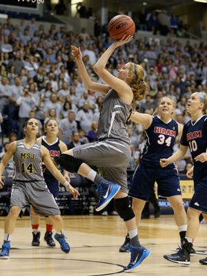 Lauren Hill of Mount St. Joseph shoots to score her first basket during the game against Hiram at Cintas Center on Nov. 2, 2014 in Cincinnati, Ohio.
