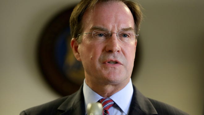 Michigan Attorney General Bill Schuette says his office is reviewing evidence in an alleged murder-for-hire plot involving a food service worker at a U.P. prison