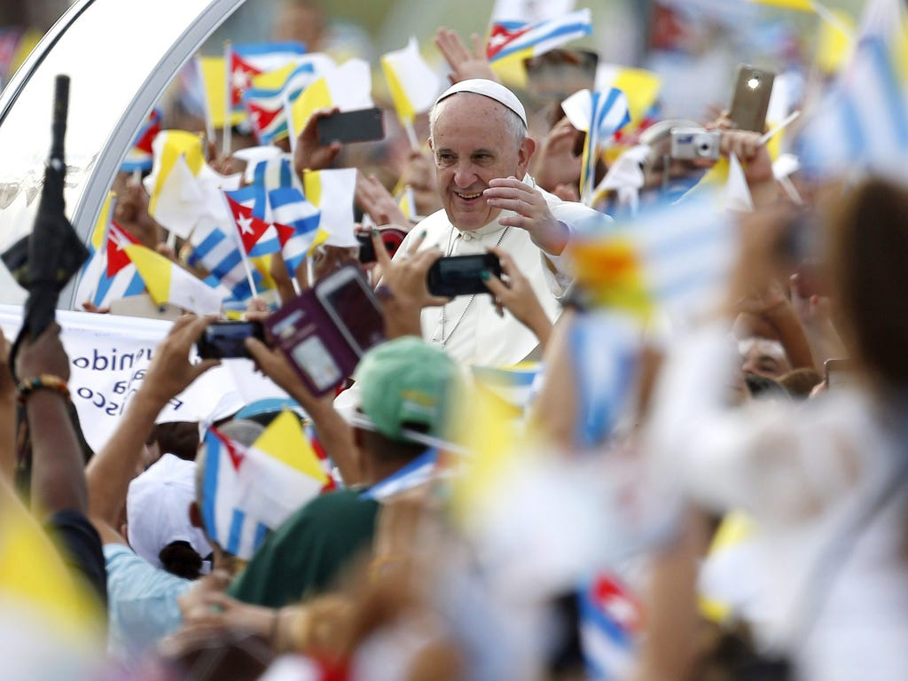 Pope Francis waves from the popemobile upon his arrival to the Revolution Plaza to celebrate a Sunday Mass in Havana.