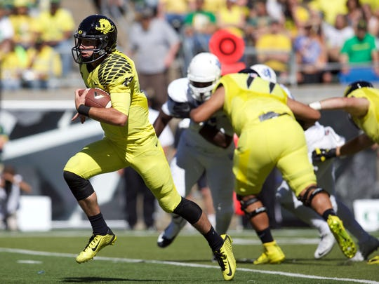 Sep 19, 2015; Eugene, OR, USA; Oregon Ducks quarterback Taylor Alie (12) runs the ball for a touchdown against the Georgia State Panthers at Autzen Stadium. Mandatory Credit: Scott Olmos-USA TODAY Sports