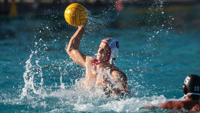 Palm Desert's Mitchell Conrow in action against Xavier College Prep in the first quarter on Tuesday, October 25, 2016 at the Palm Desert Aquatic Center.