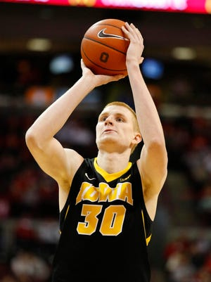 Iowa Hawkeyes forward Aaron White (30) shoots during the second half of the teams 71-65 win over the Ohio State Buckeyes at Value City Arena. White hurt his shoulder four minutes into Saturday's game against Purdue.