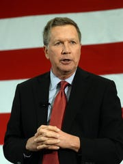 John Kasich's ad flashes through photos of candidates