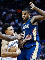Memphis Grizzlies guard Wade Baldwin IV (left) is fouled
