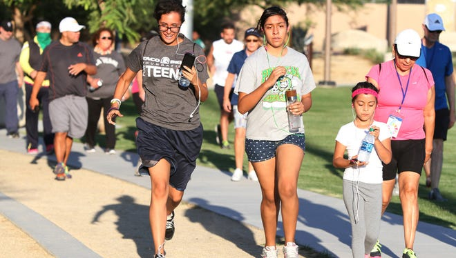 Runners and walkers plod through Coachella's Rancho Las Flores park in September 2014. Activists are working to spur voter participation in the city.