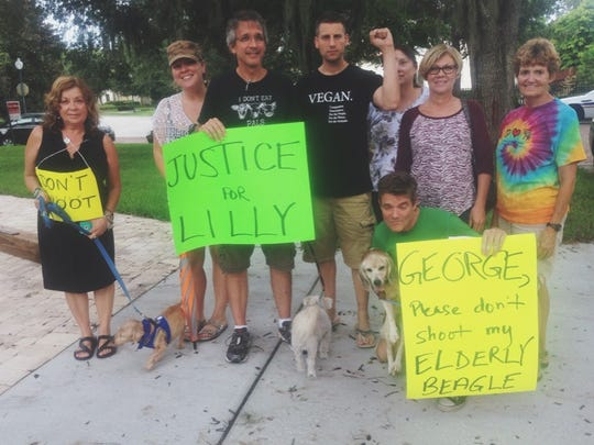 Protesters gather outside George Alan Burdock's home