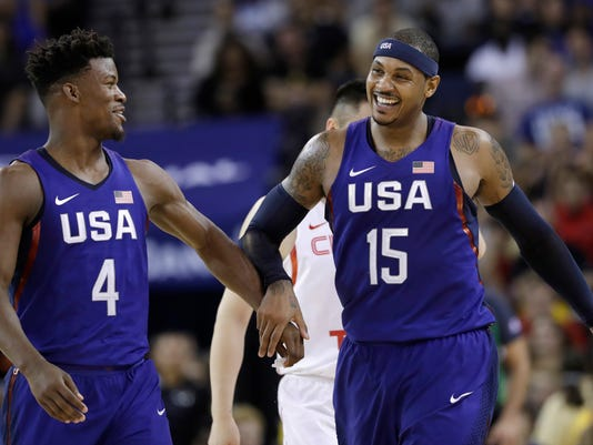 United States' Carmelo Anthony, right, celebrates after scoring, alongside teammate Jimmy Butler during the second half of an exhibition basketball game against China on Tuesday, July 26, 2016, in Oakland, Calif. The United States won 107-57. (AP Photo/Marcio Jose Sanchez)
