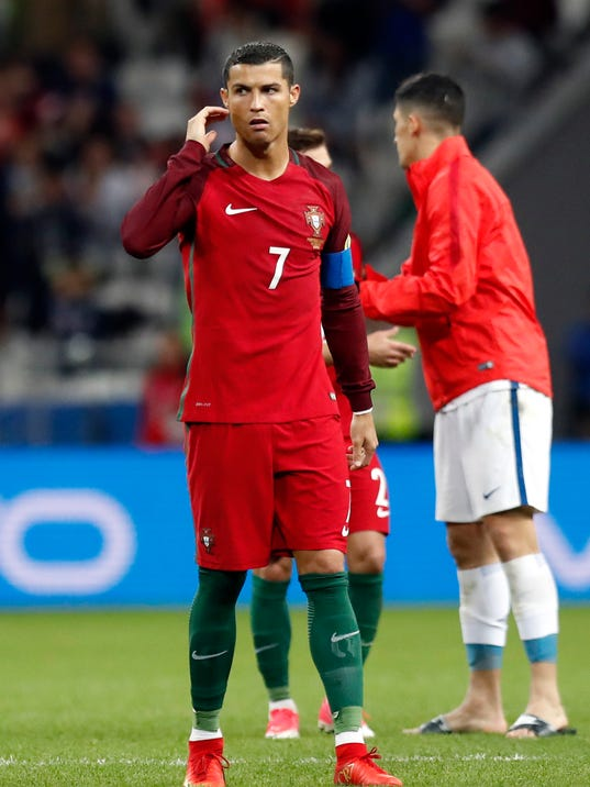 Portugal's Cristiano Ronaldo walks off the field after being defeated by Chile in a penalty shootout at the end of the Confederations Cup, semifinal soccer match between Portugal and Chile, at the Kazan Arena, Russia, Wednesday, June 28, 2017. (AP Photo/Pavel Golovkin)