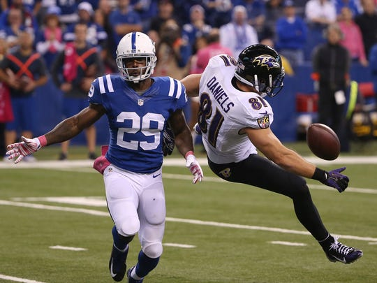 Indianapolis Colts Mike Adams keeps close to Baltimore Ravens Owen Daniels to break up a pass play in the second half. Indianapolis hosted Baltimore at Lucas Oil Stadium Sunday, October 5, 2014.