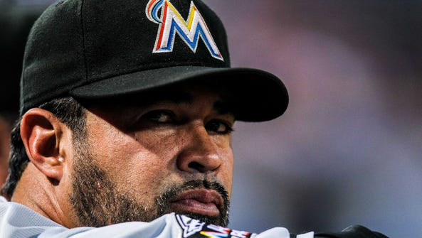 Ozzie Guillen (13) in 2012 as the Marlins' manager.