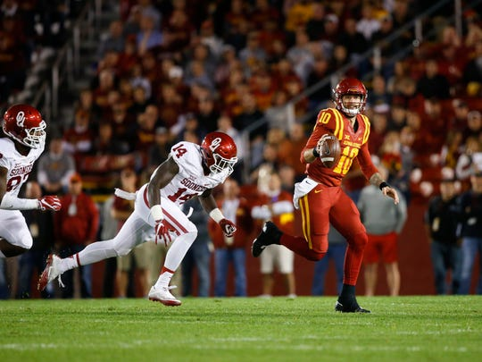 Iowa State's Jacob Park (10) scrambles during a game