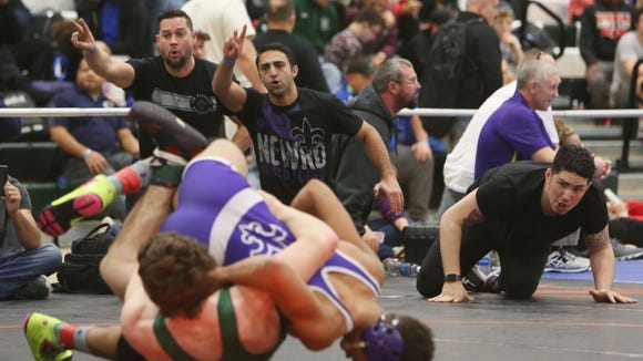 New Rochelle's Jordan Wallace on his way to defeating Alexander's Matthew Gaiser in the semifinals of the 170-pound weight class during the Eastern States Classic Wrestling Tournament at Sullivan Community College in Loch Sheldrake, N.Y. Jan. 14, 2017.