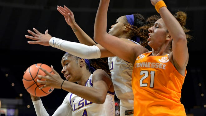 LSU forward Raven Farley (4) pulls in a rebound in front of teammate Ayana Mitchell, center, and Tennessee center Mercedes Russell (21) in the first half of Sunday's game.