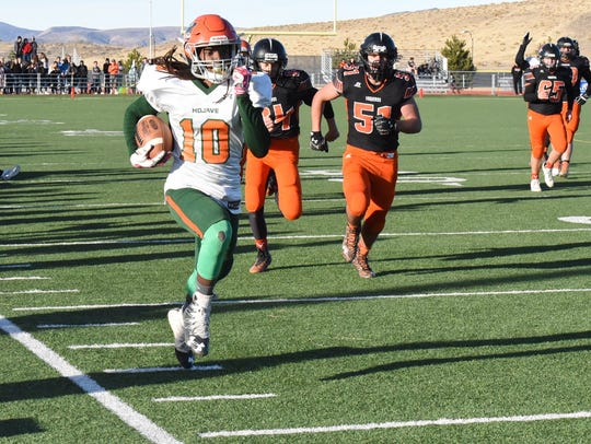 Noah Thompson streaks down the sideline for a touchdown