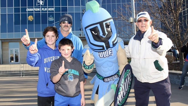 The UWF mascot poses with Michael Maddrey (back left), Jackson Maddrey (left, blue hoodie), Blaise Maddrey (front) and Jim Maddrey (right) before Saturday's NCAA Division II Championship game in Kansas City, Kansas.   Birthday wish family:    Grandfather- Jim Maddrey (white jacket)   Father- Michael Maddrey (mustache)  Birthday boy- Blaise Maddrey, 10 year old (black sweatshirt)  Brother- Jackson Maddrey, 12 years old (Blue sweatshirt)