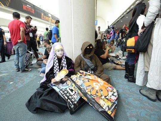 Fans  dressed as Star Wars characters take a break
