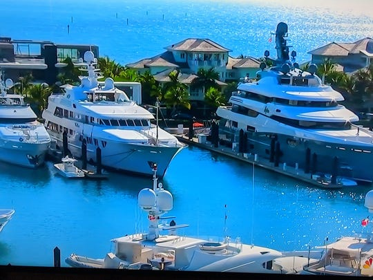 Tiger Woods' yacht 'Privacy' (far left) is docked in the Bahamas for the 2019 Hero Wold Challenge. Photo: Golf Channel