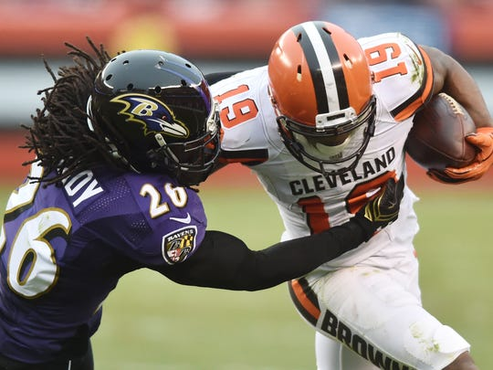 Baltimore Ravens cornerback Maurice Canady (26) tackles Cleveland Browns wide receiver Corey Coleman (19).