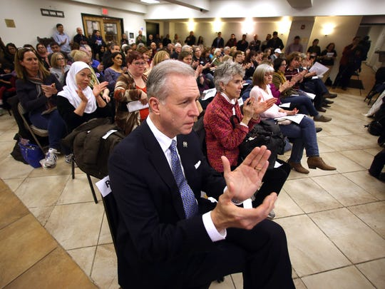 Assemblyman John S. Wisniewski applauds while listening to a panel discussion as hundreds of constituents of Republican Congressman Rodney Frelinghuysen showed up for a town hall at the Jam-E-Masjid Islamic Center in Boonton. The town hall was set up by the grassroots group, NJ 11th for Change while congress is in recess, but Frelinghuysen did not attend. February 21, 2017, Boonton, NJ.