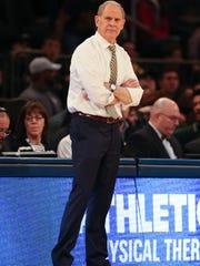 Michigan head coach John Beilein on the bench during