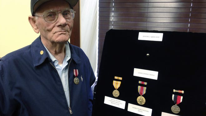 Joseph Aquilante, 91, received his World War II medals from U.S. Sen. Jack Reed, D-R.I., on Monday in Cranston, R.I. Aquilante, of North Providence, wanted the medals so he could leave them for his grandchildren and great-grandchildren.