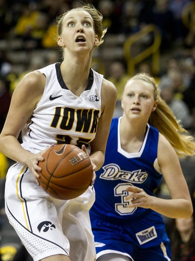 Iowa's Kali Peschel drives the lane during the Hawkeyes game against Drake in Iowa City on Saturday, December 21, 2013.
