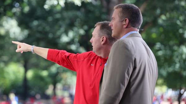 Ole Miss coach Hugh Freeze shows ESPN analyst Kirk Herbstreit the Grove on Friday.