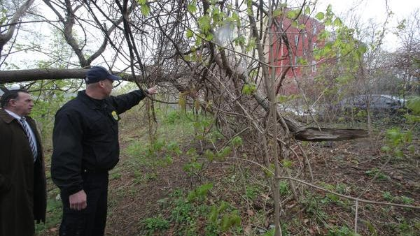 Yonkers Detective Vincent DiDio, left, looks as SPCA of Westchester Director Ernest Lungaro shows him where 25 dead cats were found in Yonkers on  April 29, 2014.
