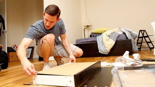 Chris Konopka, 26, who just moved out of his parent's house in Blauvelt and into his own studio apartment, builds a desk at his new home in Scarsdale on July 2.