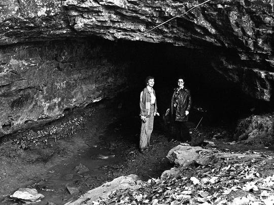 Bonnie Haneline, left, of Tennessee Ridge, Tenn., brings friend Thelma Barnes on a visit to the Bell Witch cave in Adams, Tenn. Oct. 25, 1977. Haneline spent many hours exploring the cave as a girl growing up here on the banks of the Red River.