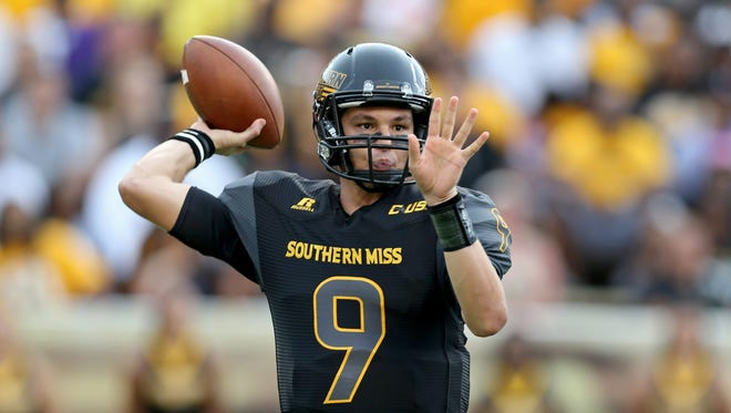 Southern Miss Golden Eagles quarterback Nick Mullens (9) makes a throw during the first quarter of their game against the Savannah State Tigers at M.M. Roberts Stadium.