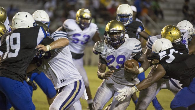 Bainbridge running back Dameon Pierce finds an opening against Godby's defense in Thursday night's preseason game at Cox Stadium. Pierce, an Alabama commit, had 152 rushing yards.