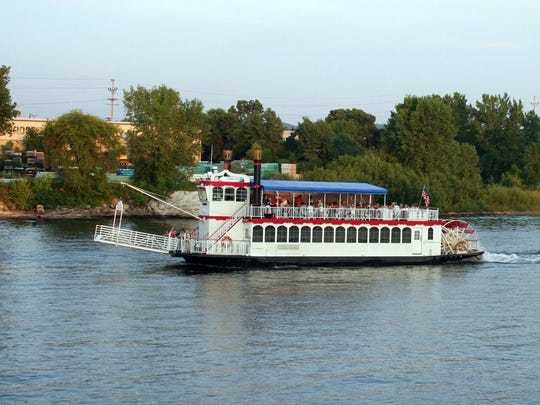 The La Crosse Queen paddlewheeler cruises the Mississippi River.