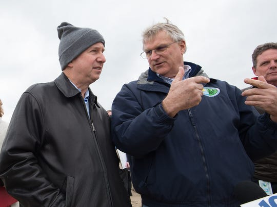 Tony Pratt, right DNREC, Administrator, Shoreline and Waterway Management Section talks with Governor Jack Markell about the beach sand status at Dewey Beach.