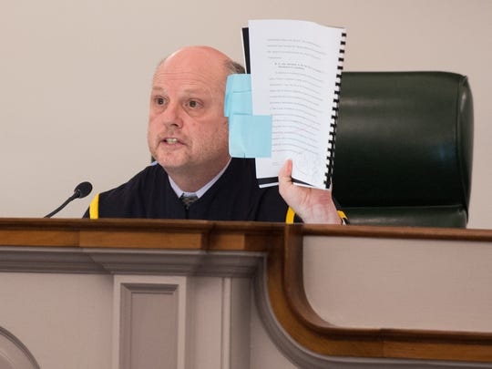 Chief Justice Leo E. Strine, Jr., holds up a brief during the oral arguments of Shawe & Elting LLC at the Delaware Supreme Court in Dover.