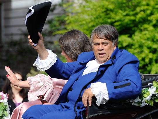 Robin R. Christiansen, Mayor of Dover, rides in a carriage