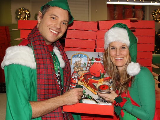 Santa's helpers Dale and Carey Gruber run the company they founded, Package from Santa, out of their Washington Township home.