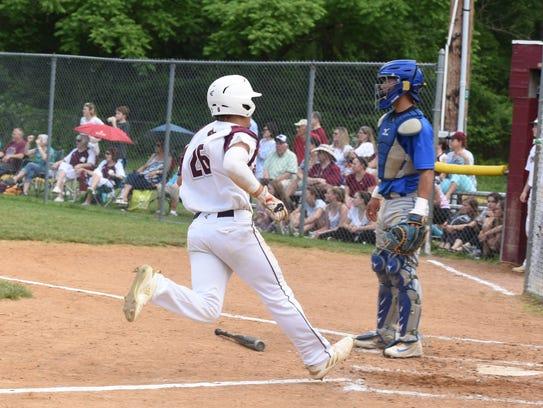 Park Ridge #26 Vincent Pinto gets on home base Park
