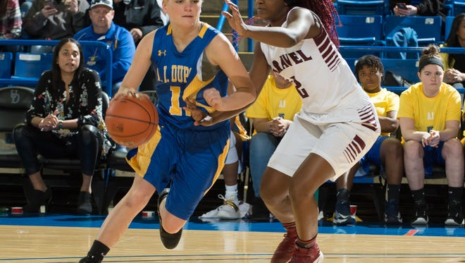 Caravel's Maia Bryson (right) defends against A.I. du Pont's Sydney MacDonald in the quarterfinals of the DIAA Girls Basketball Tournament last Saturday.