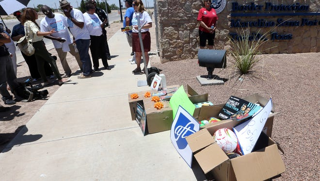 School supplies in boxes are placed outside the gates to the Marcelino Serna Port of Entry Tuesday.