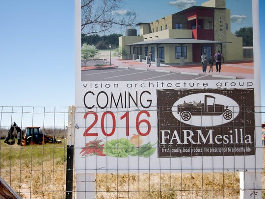 A sign promotes the future site of FARMesilla, a farm-to-market