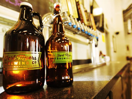 A pair of growlers from Fort Myers Brewing Co., Lee County's first microbrewery. Local beer will continue to explode in 2016.