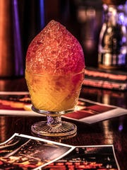 At the 'Barrels & Bites' tasting fundraiser Nov. 13 at the Peppermill, the host property is serving craft updates on '70s cocktails from its Fireside Lounge booth. Here, a tequila sunrise refashioned as a snow cone.