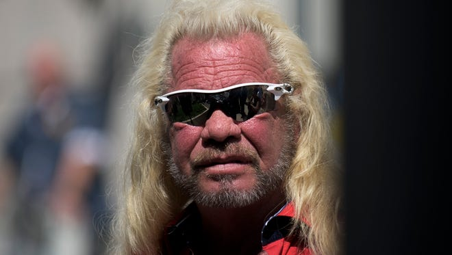 Duane 'Dog the Bounty Hunter' Chapman stands by during a July 2017 press conference in New Jersey. Chapman, who already was scheduled to come to Mansfield for an event, announced Wednesday he's joining the manhunt for Shawn Christy.